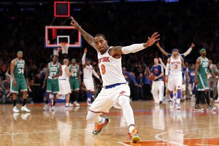 New York Knicks' J.R. Smith celebrates after sinking a three point basket at the buzzer at the end of the first quarter against the Boston Celtics in Game 2 of their NBA Eastern Conference basketball