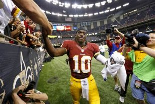Robert Griffin III was even more impressive than Peyton Manning on Sunday. (REUTERS)