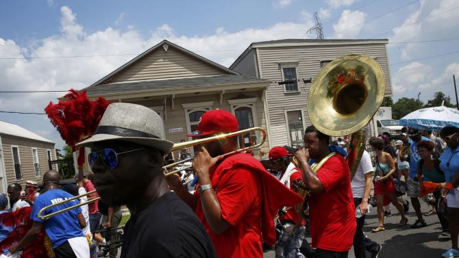 The All For One brass band performs in a second-line parade marking the 10th anniversary of Hurricane Katrina on St. Claude Avenue in New Orleans