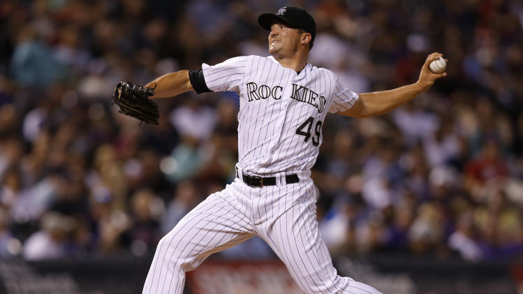 Colorado Rockies relief pitcher Rex Brothers throws against the Minnesota Twins during the seventh inning of a baseball game on Friday, July 11, 2014, in Denver. (AP Photo/Jack Dempsey)