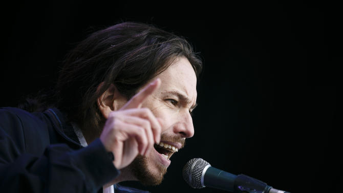 "Pablo Iglesias, leader of Spanish Podemos (We Can) left-wing party, gestures during his speech at the main square of Madrid during a Podemos (We Can) party march in Madrid, Spain, Saturday, Jan. 31, 2015. Tens of thousands of people, possibly more, are marching through Madrid's streets in a powerful show of strength by Spain's fledgling radical leftist party Podemos (We Can) which hopes to emulate the electoral success of Greece's Syriza party in elections later this year. Supporters from across Spain converged onto Cibeles fountain before packing the avenue leading to Puerta del Sol square. Podemos aims to shatter the country's predominantly two-party system and the ""March for Change"" gathered crowds in the same place where sit-in protests against political and financial corruption laid the party's foundations in 2011. (AP Photo/Daniel Ochoa de Olza)"