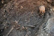 The skeleton of Richard III is seen in a trench at the Grey Friars excavation site in Leicester, central England, in this picture provided by the University of Leicester and received in London on February 4, 2013. REUTERS/University of Leicester/Handout /Files