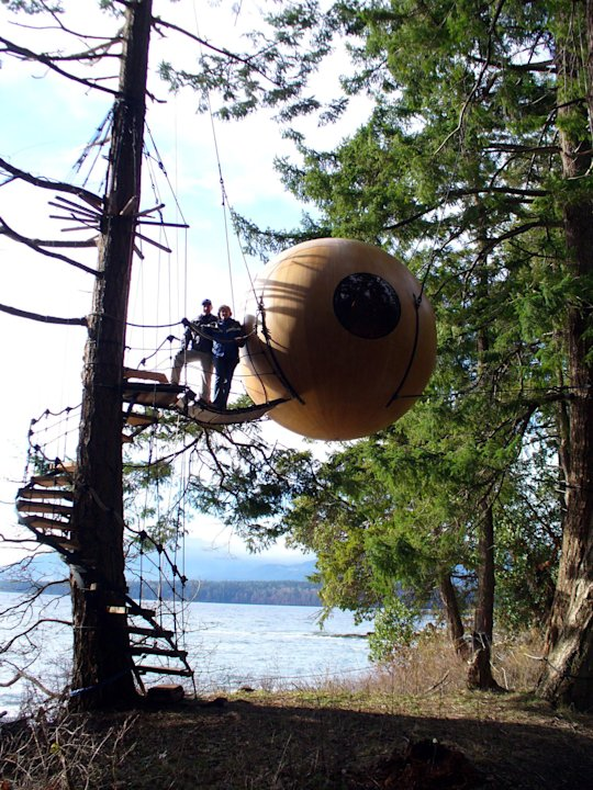 A Free Spirit Spheres treehouse is shown in Qualicum Beach on Vancouver Island in a handout photo. Climbing trees and building tree forts are common activities for kids, and often as kids grow up they