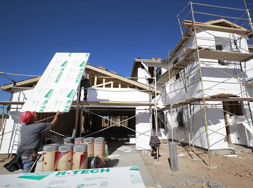 Construction workers build a house Tuesday, Nov. 30, 2010 in Gilbert, Ariz. Construction spending rose in October for the second straight month as residential building gains.(AP Photo/Matt York)