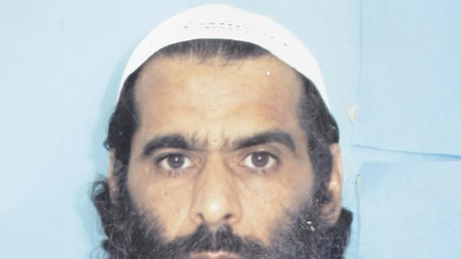 This Oct. 8, 2012 photo taken by the International Red Cross and provided by the family of Muhammed Rahim al-Afghani, shows Muhammed Rahim al-Afghani at Guantanamo Bay prison at the U.S. Naval Base in Cuba. Rahim who is being held with the most significant terrorism suspects in U.S. custody has apparently gained extensive knowledge of western pop culture in Guantanamo's Camp 7: the top secret prison-within-a-prison in Guantanamo Bay.  Nearly five years ago, Rahim became the last prisoner sent to Guantanamo. He was accused of helping Osama bin Laden elude capture. (AP Photo/International Red Cross via Rahim family)