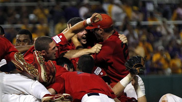 Stony Brook celebrates after defeating LSU 7-2 in game three of an NCAA college baseball tournament super regional game in Baton Rouge, La., Sunday, June 10, 2012. Stony Brook advances to the College World Series. (AP Photo/Gerald Herbert)