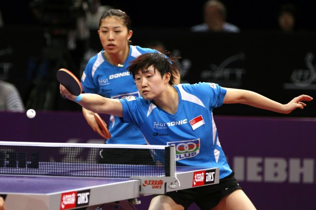 Yu Mengyu (L) and Feng Tianwei of Singapore play against Guo Yue and Li Xiaoxia of China in their women&#39;s doubles semifinals at the World Team Table Tennis Championships in Paris May 19, 2013. Guo and Li won the match. REUTERS/Charles Platiau (FRANCE - Tags: SPORT TABLE TENNIS)