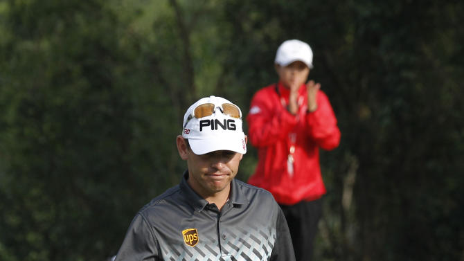 Louis Oosthuizen from South Africa celebrates after score a birdie at the 9th hole during the first round of the WGC-HSBC Champions golf tournament in Dongguan, southern China's Guangdong province, Thursday Nov. 1, 2012. (AP Photo/Kin Cheung)