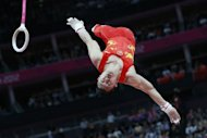 China's gymnast Chen Yibing performs to win silver in the men's rings final of the artistic gymnastics event of the London Olympic Games at the 02 North Greenwich Arena in London. Brazil's Arthur Nabarrete Zanetti won gold