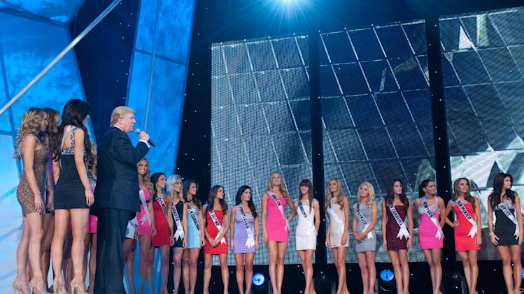 Co-Owner of the Miss Universe Organization, Donald Trump, addresses Miss Texas USA 2012, Brittany Lynn Booker; Miss Tennessee USA 2012, Jessica Hibler; Miss South Dakota USA 2012, Taylor Neisen; Miss South Carolina USA 2012, Erika Powell; Miss Rhode Island USA 2012, Olivia Culpo; Miss Pennsylvania USA 2012, Sheena Monnin; Miss Oregon USA 2012, Alaina Bergsma; Miss Oklahoma USA 2012, Lauren Taylor Lundeen; Miss Ohio USA 2012, Audrey Bolte; Miss North Dakota USA 2012, Jaci Stofferahn; Miss North Carolina USA 2012, Sydney Marie Perry; Miss New York USA 2012, Johanna Sambucini; Miss New Mexico USA 2012, Jessica Renee Martin; and Miss New Jersey USA 2012, Michelle Leonardo;  on the last day of rehearsal for the Miss USA 2012 Competition, Saturday June 2, 2012 from the Planet Hollywood Resort and Casino Theatre for the Performing Arts in Las Vegas, Nevada. The 2012 MISS USA Pageant will air LIVE on NBC June 3 at 9:00 p.m. ET from the Theatre for Performing Arts in Las Vegas. (AP Photo/Miss Universe Organization)