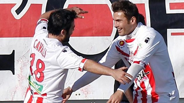 Adrian Mutu (R) is congratulated by teammates after scoring a goal during the French L1 football match Ajaccio (ACA) vs Lyon