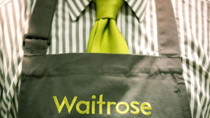 Branding on a staff member's uniform is seen in the Canary Wharf store of Waitrose in London