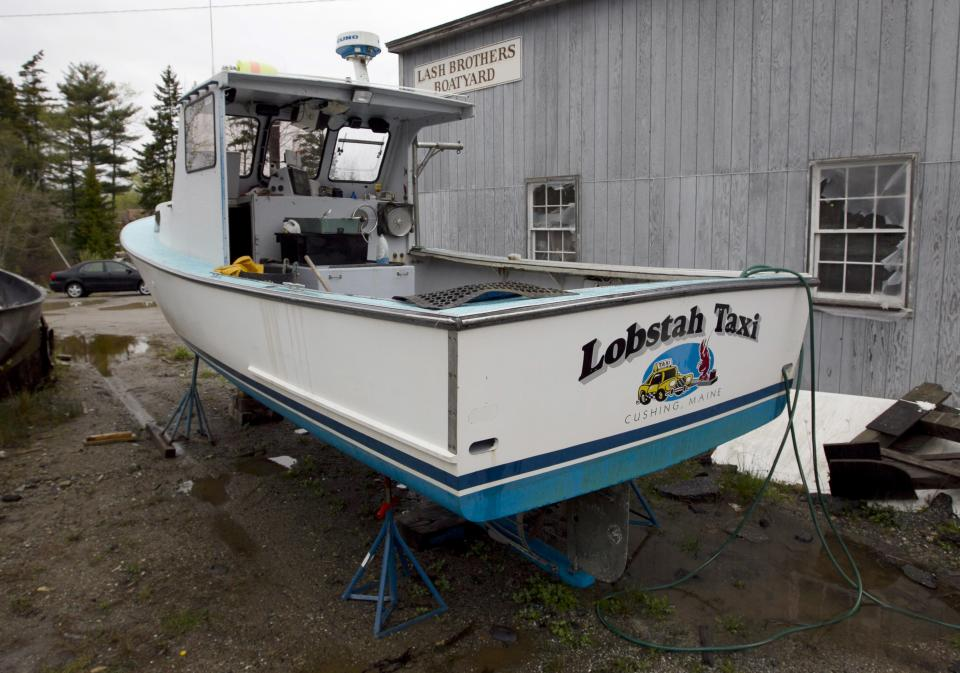 One of the two lobster boats recently sunk by vandals is seen in a boatyard in Friendship, Maine, Thursday, May 10, 2012. The sinkings are bringing back memories of territorial tensions in the industry that led to a shooting two summers ago. (AP Photo/Robert F. Bukaty)