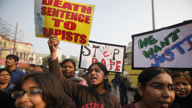 Indian students protesting against the brutal gang-rape of a woman on a  bus last week in New Delhi, hold placards during a protest in Allahabad, India, Wednesday, Dec. 26, 2012. (AP Photo/ Rajesh Kumar Singh)