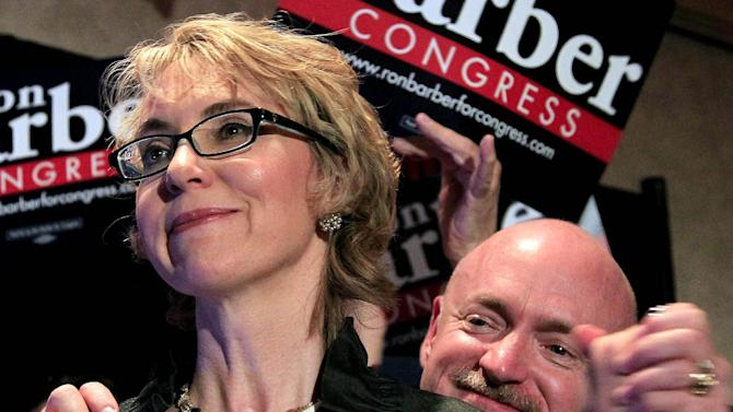 FILE - In this June 12, 2012 file photo, former Arizona Rep. Gabrielle Giffords, accompanied by her husband Mark Kelly, are seen in Tucson, Ariz. Giffords will deliver the Pledge of Allegiance at the Democratic convention .Giffords' office confirms she will deliver the pledge Thursday, the final night of the convention in Charlotte, N.C. (AP Photo/Ross D. Franklin, File, Pool)