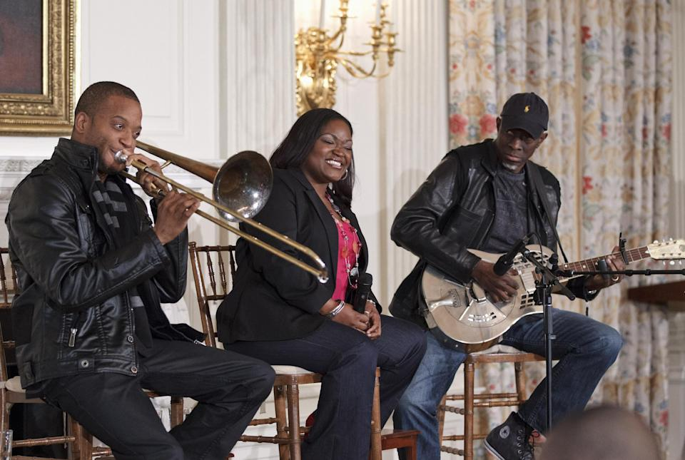 "From left, Troy ""Trombone Shorty"" Andrews, Shemekia Copeland, and Keb Mo, perform during a student workshop celebrating Blues music, Tuesday, Feb. 21, 2012, in the State Dining Room of the White House in Washington. (AP Photo/J. Scott Applewhite)"