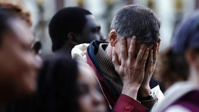 A mourner reacts during a candlelight vigil in the aftermath of Monday's Boston Marathon explosions, which killed at least three and injured more than 140, Wednesday, April 17, 2013, at City Hall in Cambridge, Mass. (AP Photo/Matt Rourke)