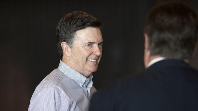 Dennis Lockhart, President of the Federal Reserve Bank of Atlanta, arrives at the opening reception of the Jackson Hole Economic Policy Symposium