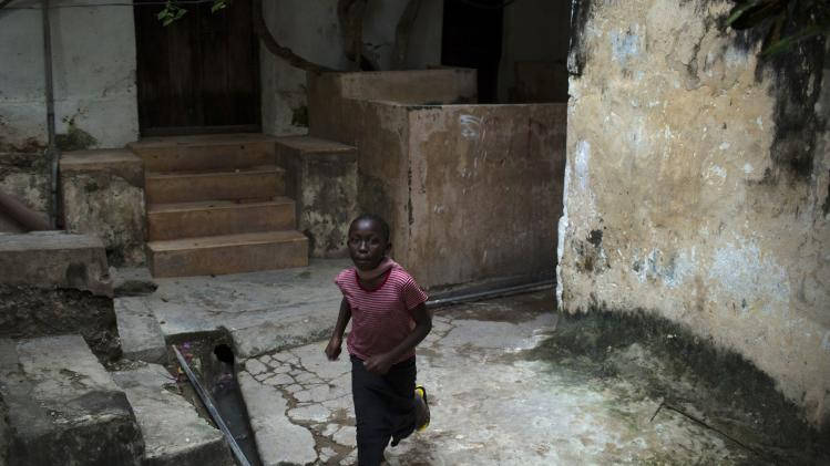 A girl runs in a street in the old part of Lamu town, the main settlement in Lamu, an island in the Indian Ocean off the northern coast of Kenya