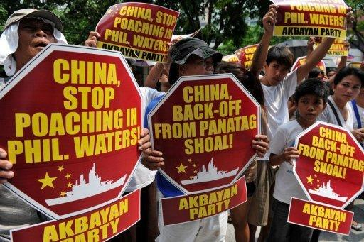 The Philippines has accused Chinese vessels of firing warning shots at Filipino fishermen