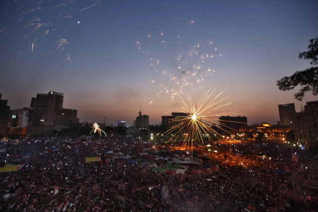 Fireworks illuminate Tahrir Square in Cairo, Egypt, as Egyptians gather to celebrate Mohammed Morsi's presidential win Sunday, June 24, 2012. Mohammed Morsi was declared Egypt's first Islamist preside