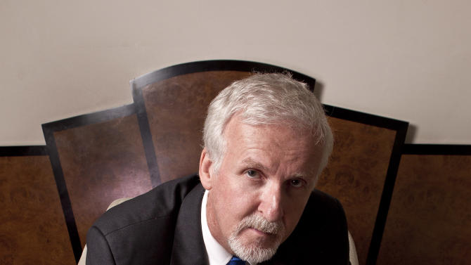 Director James Cameron is photographed during a portrait session at a central London hotel following the 'Titanic 3D' UK film premiere at the Royal Albert Hall in Kensington, West London, Tuesday, March 27, 2012. The re-launch of the Titanic 3D version comes 15 years after the film was a huge box office hit. The film director also recently completed a record dive to the bottom of the Mariana Trench, plunging 35756 feet to the depths of the ocean, spending 3 hours on the sea floor in a specially designed submarine. (AP Photo/Joel Ryan)