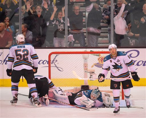 San Jose Sharks center Joe Pavelski (8), goalie Antti Niemi (31) and defenseman Matt Irwin (52) react after the Los Angeles Kings scored in the second period during Game 5 of the Western Conference se