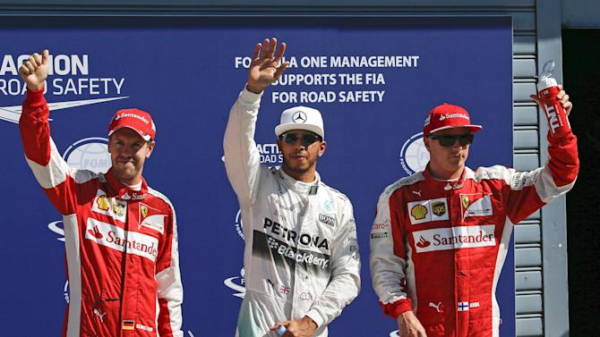 Mercedes Formula One driver Hamilton of Britain celebrates after getting the pole position at the end of the qualifying session for the Italian F1 Grand Prix in Monza