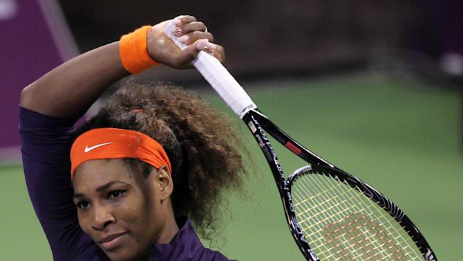 Serena Williams of the U.S. reacts during her quarterfinal match against Petra Kvitova of Czech Republic during the WTA Qatar Ladies Open tennis tournament in Doha, Qatar, Friday, Feb. 15, 2013. (AP Photo/Osama Faisal)