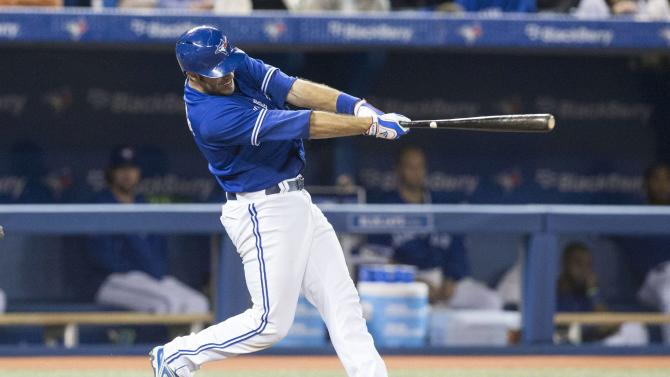 Toronto Blue Jays' J.P. Arencibia hits a two-run home run against the Boston Red Sox during the fourth inning of a baseball game in Toronto on Saturday, April 6, 2013.(AP Photo/The Canadian Press, Chris Young)
