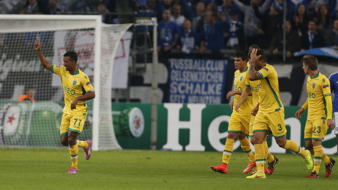 Sporting's Nani, left, celebrates his side's goal during the Champions League group G soccer match between Schalke 04 and Sporting in Gelsenkirchen, Germany, Tuesday, Oct. 21, 2014.(AP Photo/Frank Augstein)