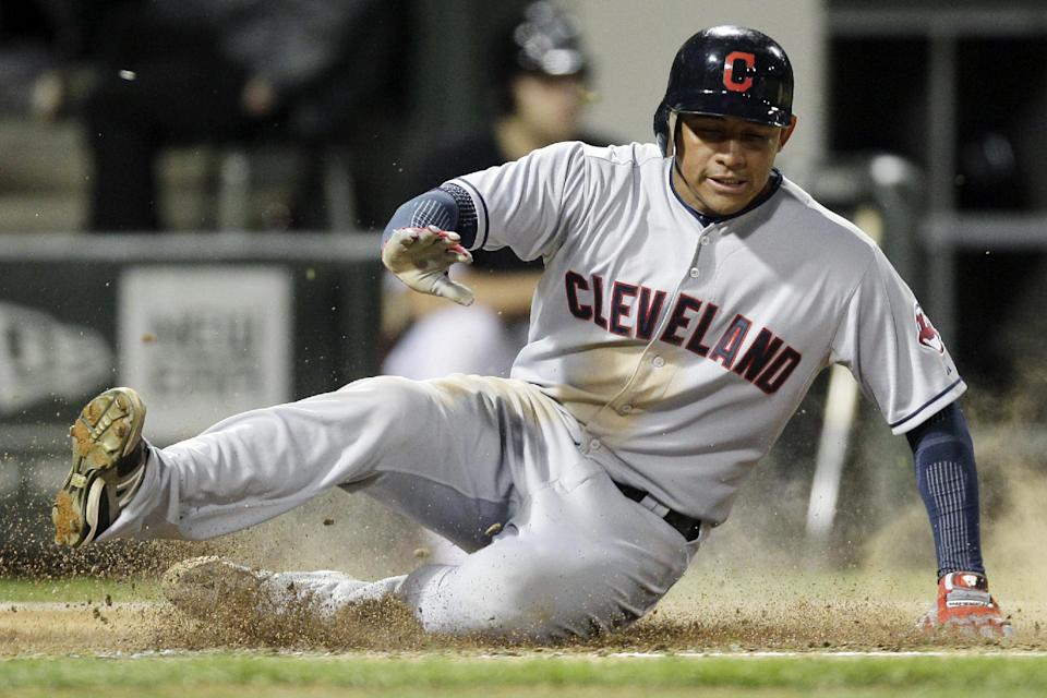 Cleveland Indians' Ezequiel Carrera scores on a single hit by Jason Kipnis during the fourth inning of a baseball game against the Chicago White Sox in Chicago, Wednesday, Sept. 26, 2012. (AP Photo/Nam Y. Huh)