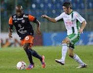 Montpellier&#39;s Senegalese forward Souleymane Camara (L) vies with Saint-Etienne&#39;s French midfielder Jeremy Clement (R) during the French L1 football match Montpellier (MHSC) vs Saint Etienne. The matched ended 1-1