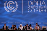 Delegates attend the last day of the UN climate talks in Doha, on December 7. A UN conference has passed a package of agreements combating climate change and extended the life of the Kyoto Protocol, the only binding pact on curbing Earth-warming greenhouse gas emissions, its chairman said
