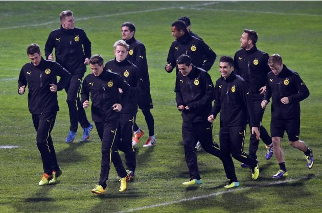 Borussia Dortmund's players run during a training session in Marseille