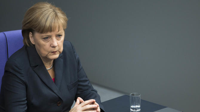German Chancellor Angela Merkel reacts before her speech prior to the upcoming G20 summit at the Bundestag in Berlin, Germany, Thursday, June 14, 2012. Merkel acknowledged Thursday that Europe's lingering debt crisis will dominate this weekend's summit of the world's 20 most important economies in Mexico, while reiterating her conviction that the crisis can only be solved through a combination of fiscal tightening and structural reforms.  (AP Photo/Markus Schreiber)
