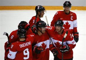 Canada's Benn celebrates with teammates after their win over Team USA at the conclusion of the men's ice hockey semi-final game at the 2014 Sochi Winter Olympic Games