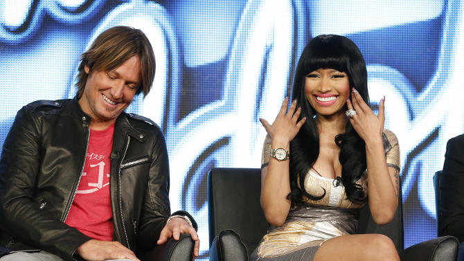 """Keith Urban and Nicki Minaj from """"American Idol"""" attend the Fox Winter TCA Tour at the Langham Huntington Hotel on Tuesday, Jan. 8, 2013, in Pasadena, Calif. (Photo by Todd Williamson/Invision/AP)"""