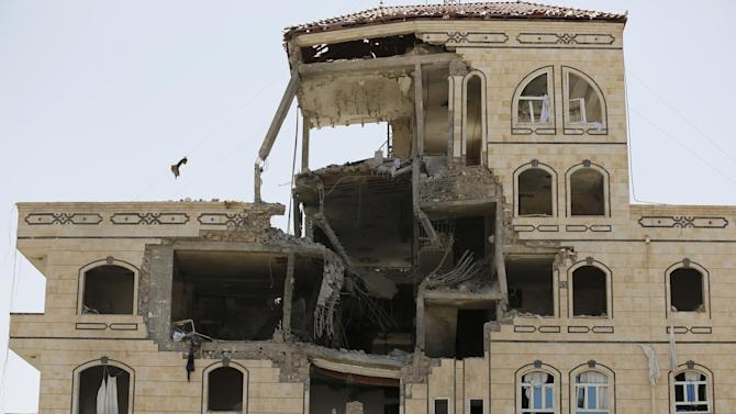 Damage is seen in the building of the Houthi movement's politburo after it was hit by a Saudi-led air strike in Yemen's capital Sanaa
