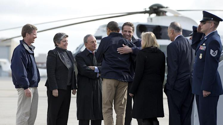 President Barack Obama is hugged by New York Gov. Andrew Cuomo upon his arrival at JFK International Airport in New York, Thursday, Nov. 15, 2012, en route to visit areas devastated by Superstorm Sandy. From left are, Housing and Urban Development Secretary Shaun Donovan, Homeland Security Janet Napolitano, New York City Mayor Michael Bloomberg, Sen. Kirsten Gillibrand, D-N.Y., and Sen. Charles Schumer, D-N.Y.  (AP Photo/Carolyn Kaster)