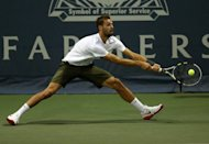 Benoit Paire of France hits a return to Michael Russell during day four of the Farmers Classic Presented By Mercedes-Benz at LA Tennis Center at the University of California, Los Angeles, on July 26. Russell won 7-5, 6-4