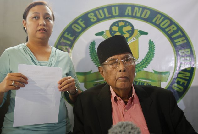 Princess Jacel Kiram, stands beside her father, former Sultan of Sulu Jamalul Kiram III, after reading a statement during a news conference inside their residence at Maharlika village, Taguig city, south of Manila February 26, 2013. President Benigno Aquino, on Tuesday, appealed to the former Sultan of Sulu to convince his followers to return home and end the two-weeks standoff but at the same time warned the government may take legal action against him. Around 200 armed men who said they are followers of the Sultan of Sulu, remained at a coastal village on the eastern Malaysian state of Sabah, as Philippines and Malaysian authorities work out a peaceful means to resolve the two-weeks standoff that threatens the two countries diplomatic relations.   REUTERS/Romeo Ranoco (PHILIPPINES - Tags: POLITICS CIVIL UNREST)