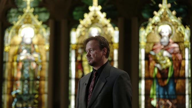 FILE - In this Thursday, Dec. 19, 2013 file photo, former United Methodist pastor Frank Schaefer speaks with reporters after a news conference at First United Methodist Church of Germantown in Philadelphia. United Methodist church officials have defrocked Schaefer, who officiated his son's gay wedding in Massachusetts. The dispute among United Methodists over recognition of same-sex couples has lapsed into a doctrinal donnybrook, pitting clergy who are presiding at gay weddings in defiance of church law against proponents of traditional marriage who are trying to stop them. (AP Photo/Matt Rourke)