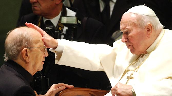 """FILE - In this Nov. 30, 2004 file photo, Pope John Paul II gives his blessing to father Marcial Maciel, founder of Christ's Legionaries, during a special audience the pontiff granted to about four thousand participants of the Regnum Christi movement, at the Vatican. First, one of the Legion of Christ's top officials abruptly quit the troubled religious order in frustration over the slow pace of change. Then priests in the cult-like movement empowered protégés of or associates of the order's disgraced founder, the Rev. Marcial Maciel, to vote for their next leader. The past month has seen several problematic developments in the Legion's efforts to rehabilitate itself as it moves toward electing a new leadership next month in what it hopes will be the culmination of a three-year Vatican experiment to overhaul a damaged order. Yet behind the scenes, high-ranking members continue to speak nostalgically and even reverently of Maciel _ a sexual predator who fathered three children and was, in the words of Vatican-appointed investigators, """"devoid of scruples and authentic religious meaning."""" (AP Photo/Plinio Lepri, File)"""