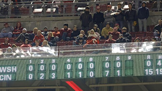 Fans watch in the ninth inning of a baseball game between the Cincinnati Reds and the Washington Nationals, Friday, April 5, 2013, in Cincinnati. Cincinnati won 15-0 on 19 hits, six of them home runs. (AP Photo/Al Behrman)