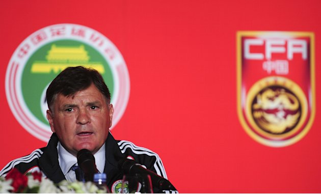 Former Real Madrid and Spain boss Jose Antonio Camacho attends a press conference in Beijing on August 14, 2011. Camacho took over China's beleaguered national football team as the underachieving