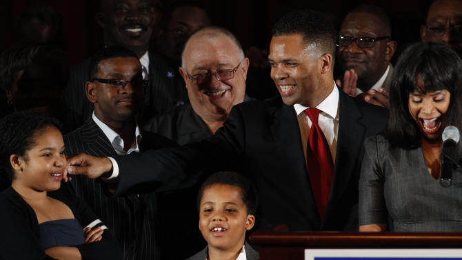 FILE - This March 20, 2012 file photo shows Rep. Jesse Jackson Jr., D-Ill., his wife Chicago Alderman Sandi Jackson, and their children Jessica, 12, and Jesse III, 8, thanking supporters at his election night party in Chicago after his Democratic primary win over challenger, former Rep. Debbie Halvorson, in the Illinois' 2nd District. A spokesman for House Speaker John Boehner says he has received letter of resignation from Rep. Jesse Jackson Jr. Wednesday.  (AP Photo/M. Spencer Green, File)