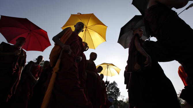 Buddhist monks walk during the street march ahead of a prayer session, denouncing the proposed U.N. Human Rights Council resolution on alleged rights abuses during the country's civil war, in Colombo, Sri Lanka, Monday, March 19, 2012. Hundreds of Buddhist, Hindu, Muslim and Christian clergy representing the main religions of Sri Lanka too part in a ceremony to pray for the defeat of a United States-backed resolution urging the country to investigate allegations of war crimes in the final stages of the country's civil war. The resolution is expected to be put to voting at the United Nations Human Rights Council sessions in Geneva this week. (AP Photo/Gemunu Amarasinghe)