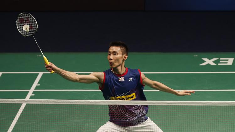 Malaysia's Lee hits a return to Denmark's Jorgensen during their men's single match at the Malaysia BWF world superseries finals 2013 in Kuala Lumpur