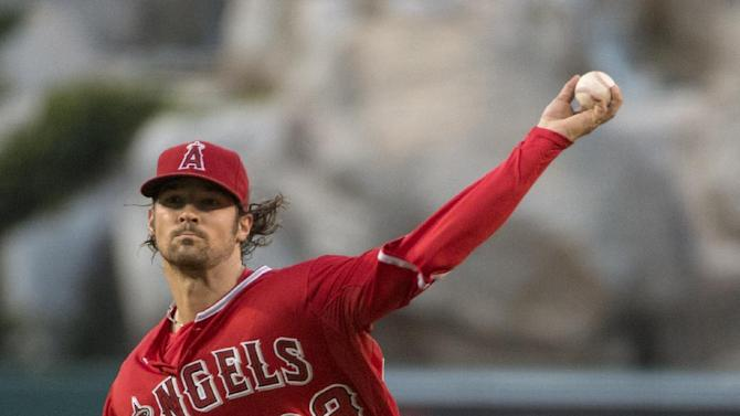 Los Angeles Angels' CJ Wilson delivers a pitch during a baseball game against the Detroit Tigers Thursday, May 28, 2015,  in Anaheim, Calif. (Kyusung Gong/The Orange County Register via AP)   MAGS OUT; LOS ANGELES TIMES OUT; MANDATORY CREDIT